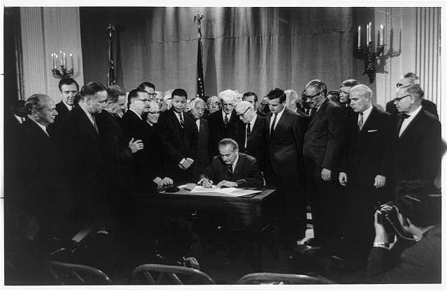 President Lyndon B Johnson signing the Civil Rights Bill, April 11, 1968. Courtesy: Warren Leffler, US News & World Report, donated to Library of Congress Prints and Photographs Division, cph.3b41629